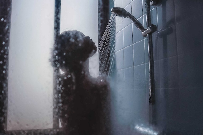 Shadow of woman showering