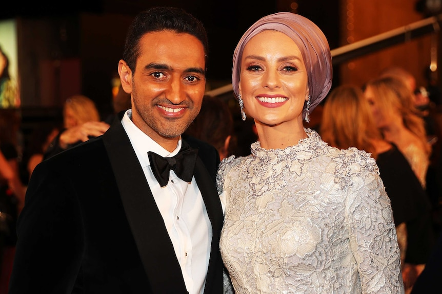 Waleed Aly and his wife susan pose in the foyer of melbourne's crown casino