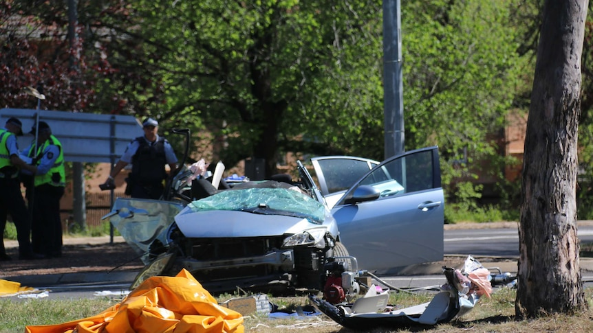 A broken car with smashed windows and chassis.