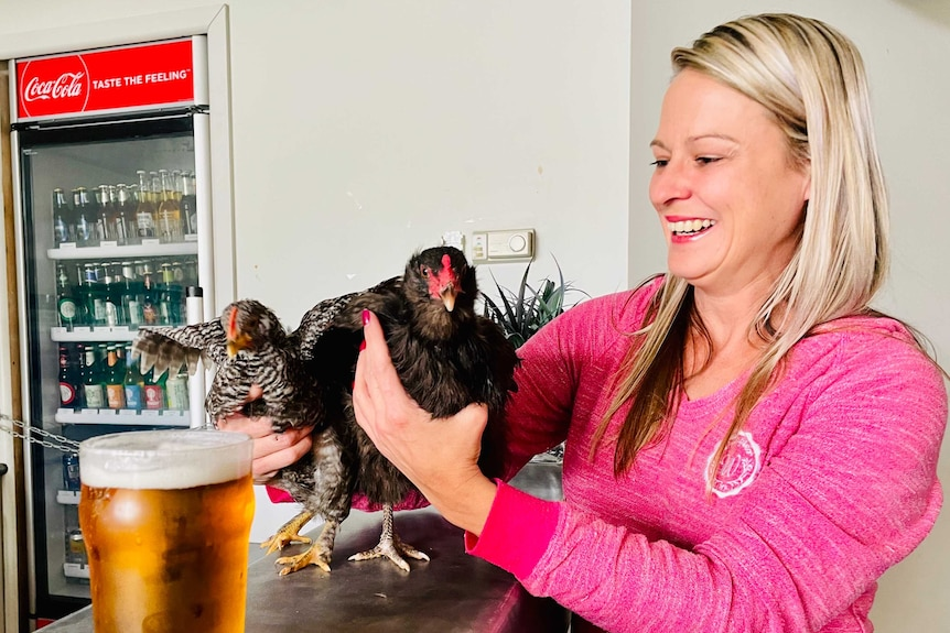 Two chooks on the bar at the Paynesville pub, with owner Jaclyn Robinson.
