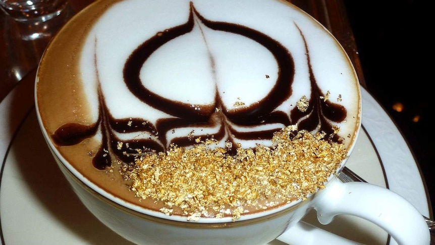 A coffee topped with gold flakes.
