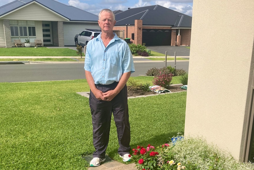A man standing on a lawn