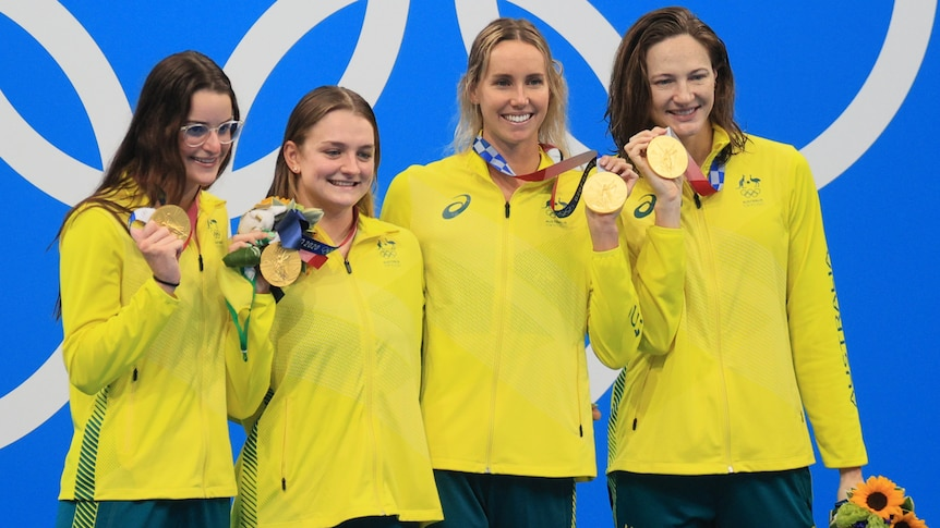 Australian women's 4x100m medley relay with their Olympic gold medals