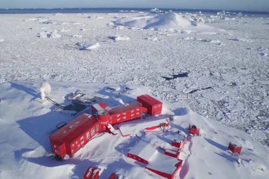 A collection of red buildings on white ice