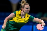 A female table tennis player uses a backhand during a game at the 2016 Paralympics.