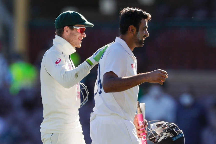 Australia wicketkeeper Tim Paine smiles as he puts his hand on the back of India batsman Ravi Ashwin after the SCG Test.