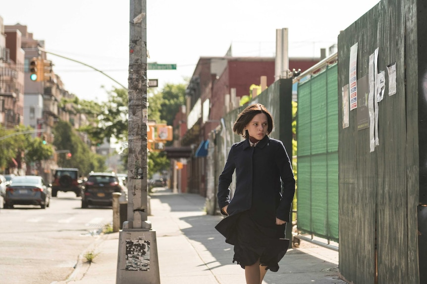 A scene from Unorthodox with Shira Haas as an Orthodox Jewish woman running down a street in New York