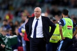 Graham Arnold looks on after Sydney FC's loss to Melbourne Victory