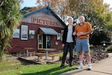 Jan and Peter Cotter stand out the front of Huskisson Pictures.