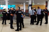 Some of the 700 extra police arriving at Cairns Airport for the G20 finance summit.