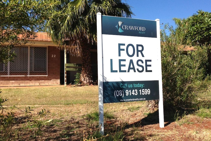 A for-lease sign outside a brick house in Karratha