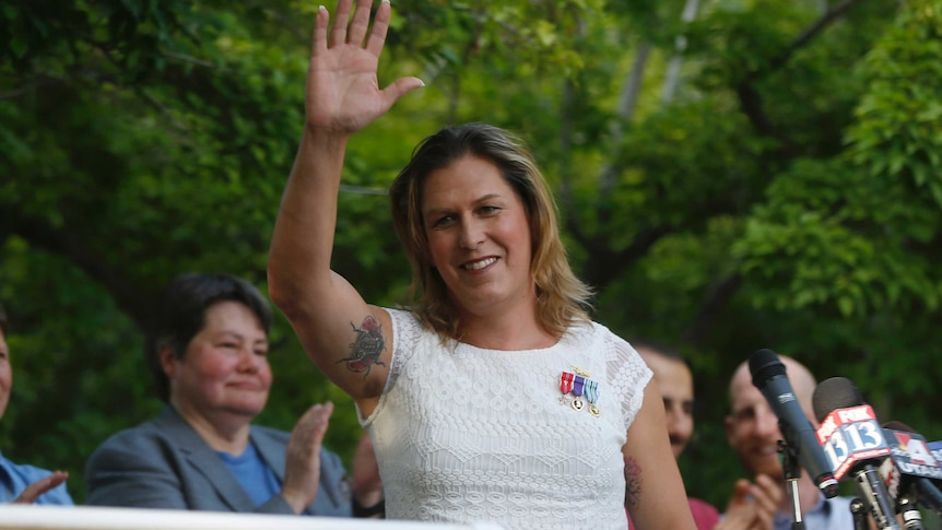 Kristin Beck waves to crowds at a same-sex marriage rally in Utah, 2014.