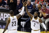Cleveland Cavaliers' LeBron James (23) and Kyrie Irving (2) high five during second half of game three of NBA finals.