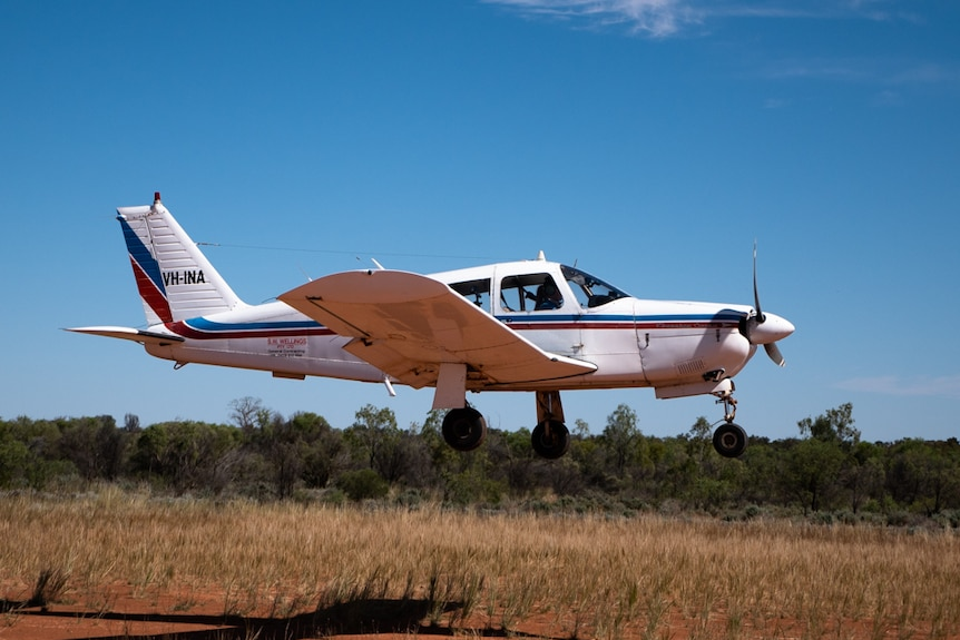 A small white plane captured moments after take-off in outback New South Wales.
