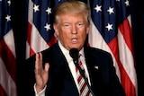 Donald Trump speaks at a lectern in Philadelphia.