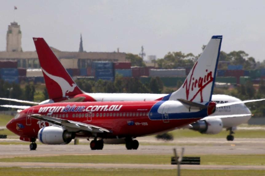 Qantas and Virgin planes on tarmac
