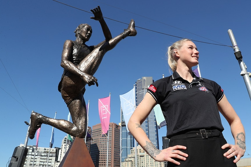 AFLW star Tayla Harris at the unveiling of a prototype statue.