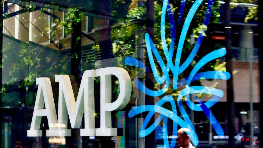 AMP logo in the window of the wealth manager and bank's Sydney CBD branch, with people reflected in glass.