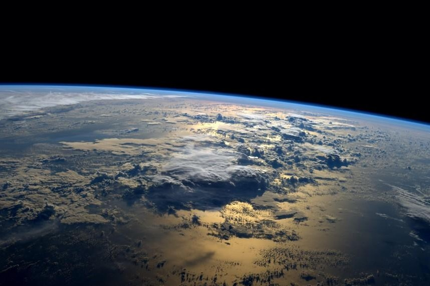 Sunrise over the planet from space