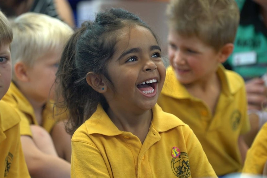A little indigenous girl laughing