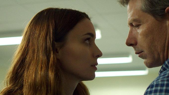 Darkly lit, Mara's character stares starkly into Mendelsohn's eyes.