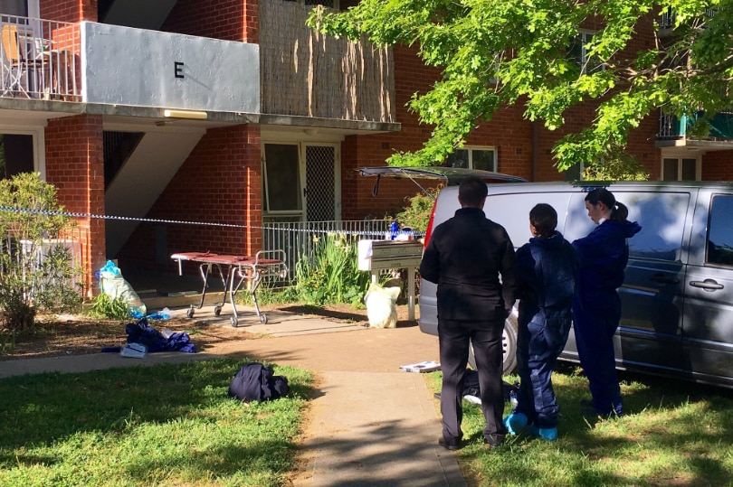 Forensic officers inspect Watson unit where Eden Waugh died.