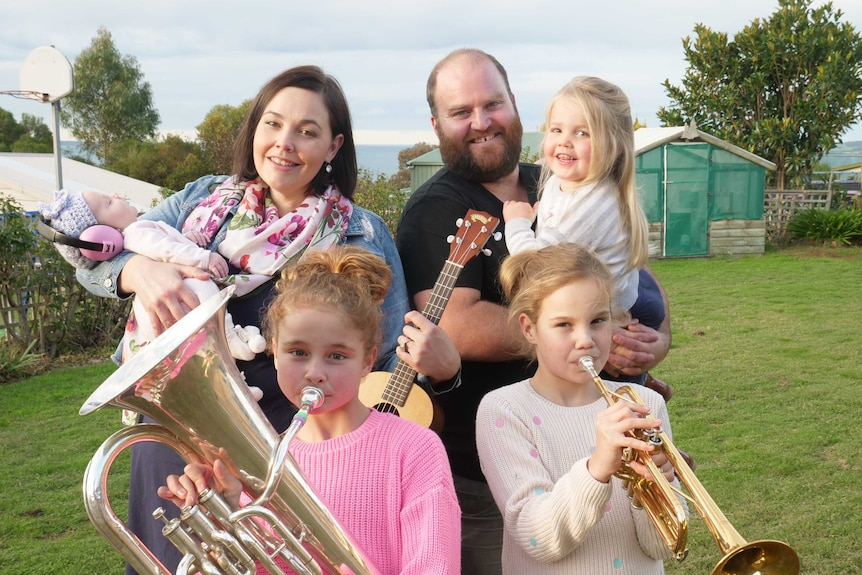 A family playing musical instruments.