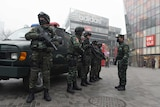 Armed police stand outside a popular shopping locale in Beijing.