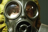 A studio shot of a soldier wearing a gas mask