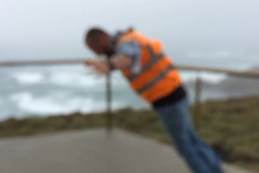 Tour guide takes on 140kph winds at Woolnorth wind farm in northwest Tassie