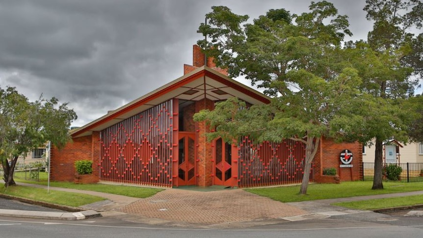 An usual-looking red brick church building.