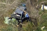 Police look into the crashed car