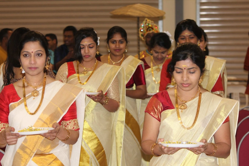 The Onam Harvest Festival usually includes traditional dancing and singing.