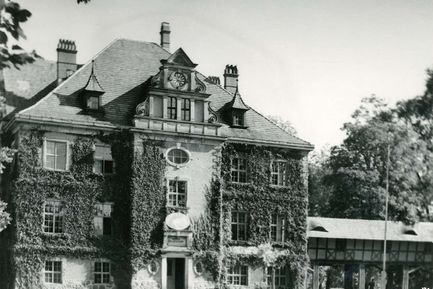 A black and white image of a German mansion