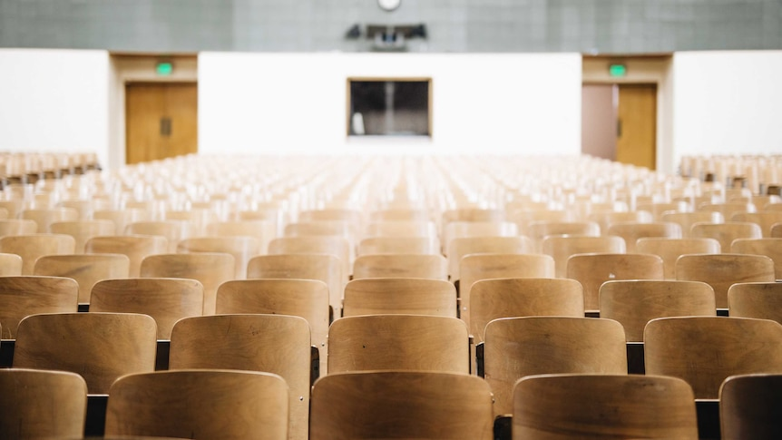 An empty university lecture hall.