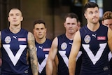 A number of Victoria players, including Trent Cotchin and Dustin Martin, walk up the race and onto the ground.