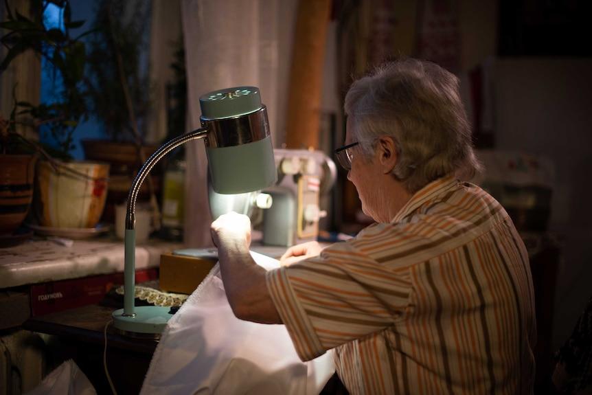 Nina sewing.
