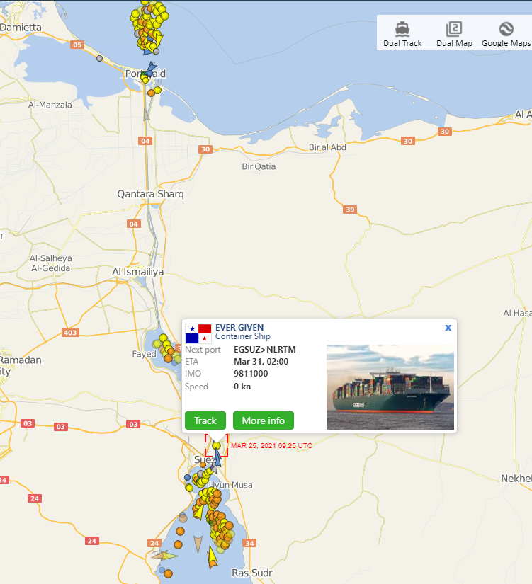 A screenshot of a map with multiple dots that represent ships trying to get through the blocked Suez Canal