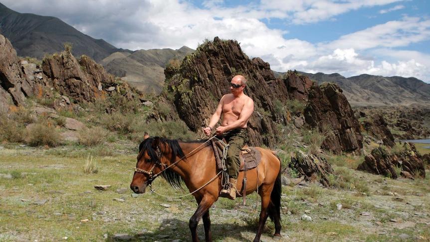 Russia's President Vladimir Putin rides a horse, shirtless, in southern Siberia's Tuva region