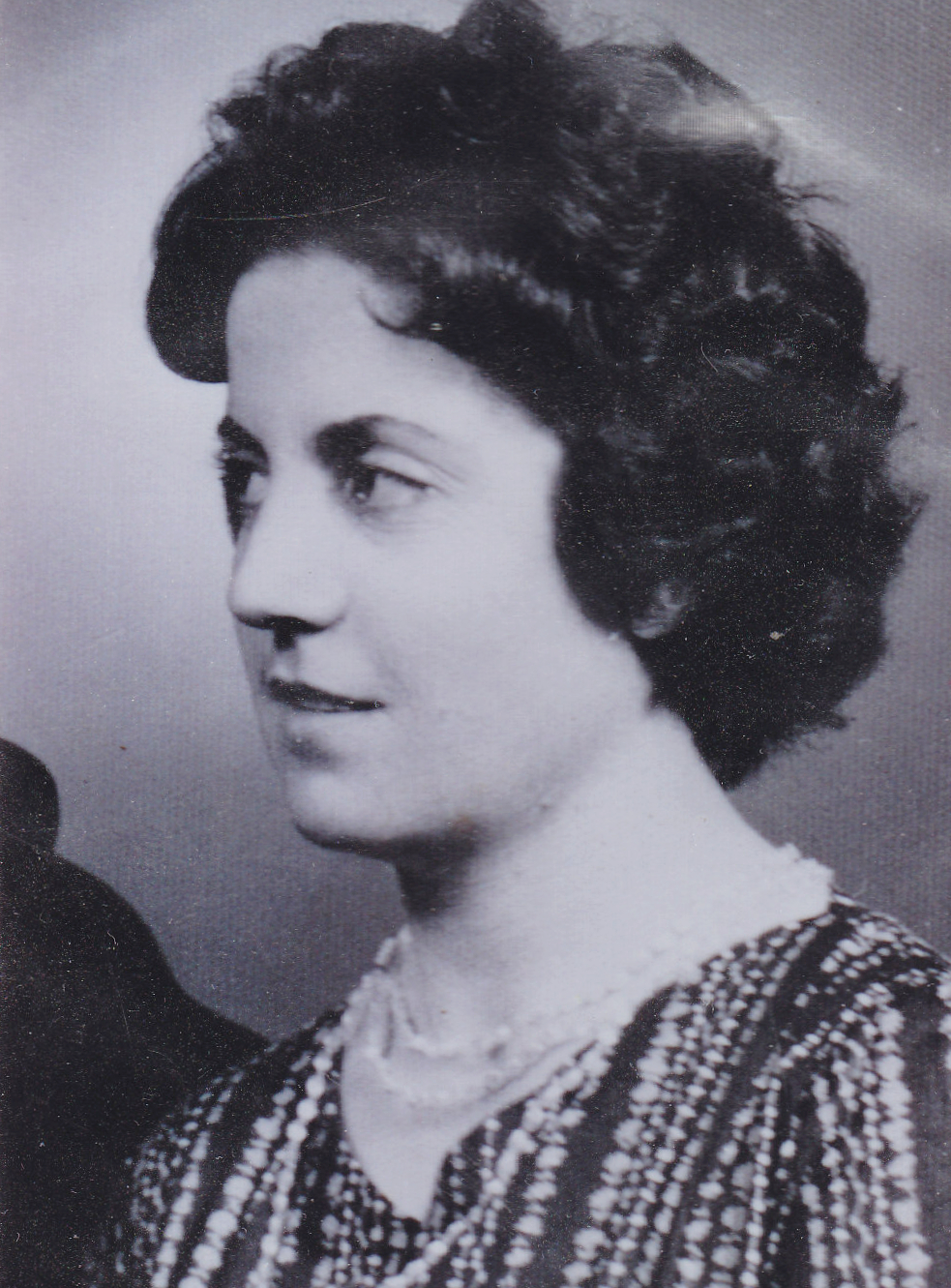 A black and white photo of a woman in profile for a story on Peter Papathanasiou's family history.