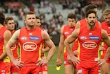 The Gold Coast Suns walking from the field.