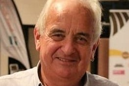 A close head and shoulders photo of an older man.