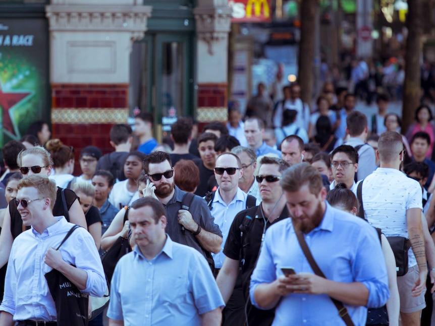Pedestrians cross at Flinders Street