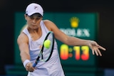 Ash Barty watches the ball as she plays a backhand return at the Australian Open.