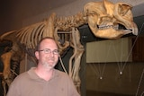 Queensland Museum's Senior Curator, Doctor Scott Hocknull with one of the dinosaurs from the Museums pre-historic collection.