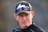 South Sydney's NRL coach stands with his arms folded at a training session in Canberra.