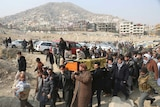 Men carry the coffin of a relative who died in Saturday's deadly suicide attack inKabul.
