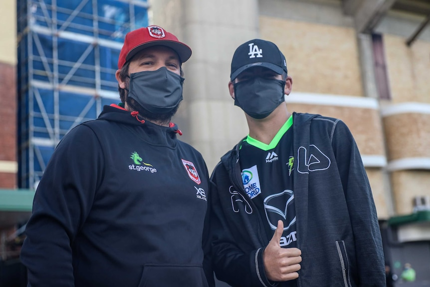Two guys in masks outside the SCG