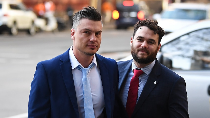 Two men in suits.