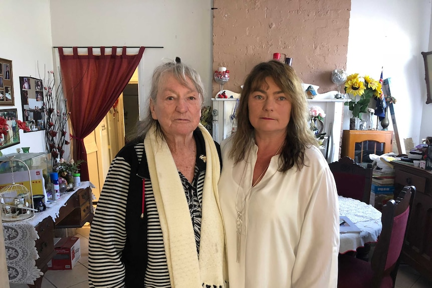 Margareth Summers and her daughter Margaret Shumack stand together in the dining room of their family home